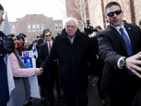 Democratic U.S. presidential candidate Bernie Sanders shakes hands with supporters outside a polling place in Concord, New Hampshire February 9, 2016.   REUTERS/Shannon Stapleton - RTX267JP
