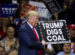 Republican presidential nominee Donald Trump  holds a sign supporting coal during a rally at Mohegan Sun Arena in Wilkes-Barre, Pennsylvania on October 10, 2016. / AFP / DOMINICK REUTER        (Photo credit should read DOMINICK REUTER/AFP/Getty Images)