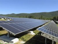 A portion of the Stafford Hill solar power project gathers energy from the sun in Rutland, Vt., on Tuesday, Sept. 15, 2015.  With the completion of the project developed by Green Mountain Power, Vermont's largest electric utility, the city of Rutland claimed it has more solar capacity, 7.8 megawatts, per capita than any other city in the New England region. (AP Photo/Wilson Ring)