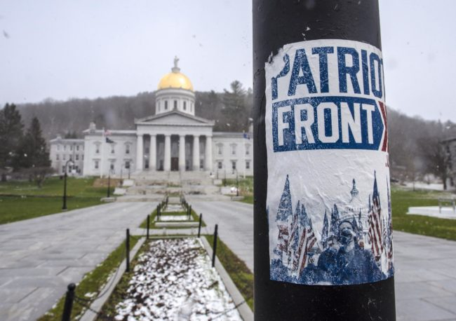 A Patriot Front sticker is seen on a historic marker sign in front of the Statehouse in Montpelier on Wednesday, April 22, 2020. The Patriot Front is considered a white nationalist hate group by the Southern Poverty Law Center. Photo by Glenn Russell/VTDigger